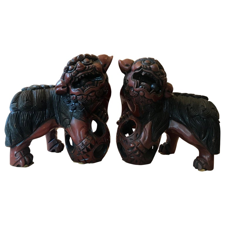 Pair of Carved Wood and Lacquered Foo Dogs For Sale