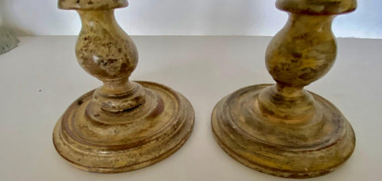 Pair of charming small painted turned carved wood candle holders or candlesticks.