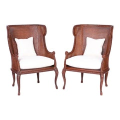 Pair of Carved Wood Wingback Rope and Tassel Armchairs