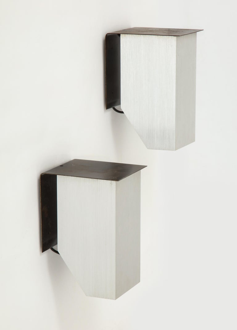 Cast aluminum modern sconce, France, circa 1970.