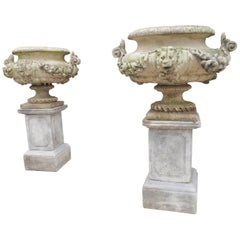 Pair of Cast and Patinated Stone French Lion Vases on 3-Piece Plinths