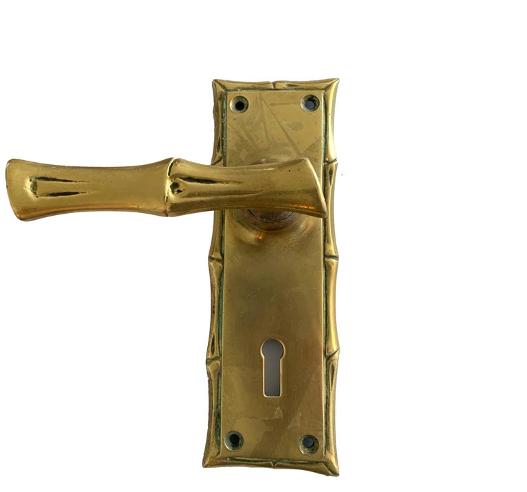 """Set of two cast brass faux bamboo door handles. One left facing and one right facing. Faux bamboo handle is 4"""" wide. Each backplate is 6"""" tall x 2"""" wide x 2"""" deep Installation hardware not included. Overall unpolished patina. Can be re-plated in"""