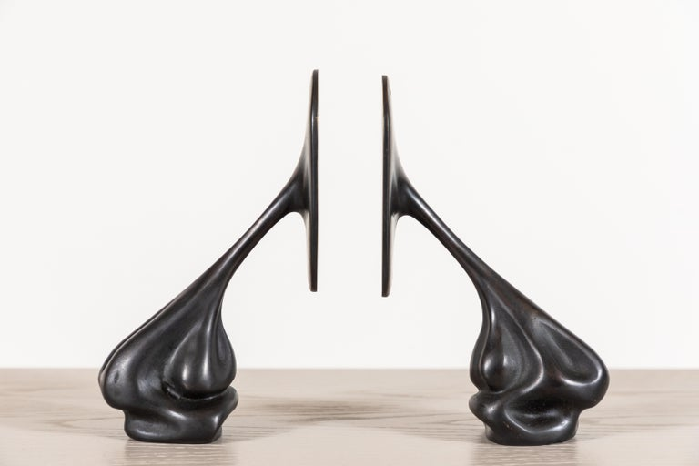 Pair of cast bronze bookends by artist Vincent Pocsik in collaboration with Lawson-Fenning. Made of natural materials, this decorative object can be accessorized on tabletop, book shelf, or desk to achieve an organic modern style.   Vincent Pocsik