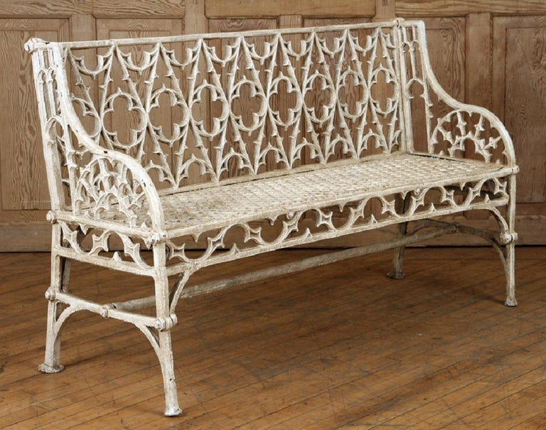 A pair of cast iron Gothic style garden benches in the manner of Coalbrookdale, 20th century.