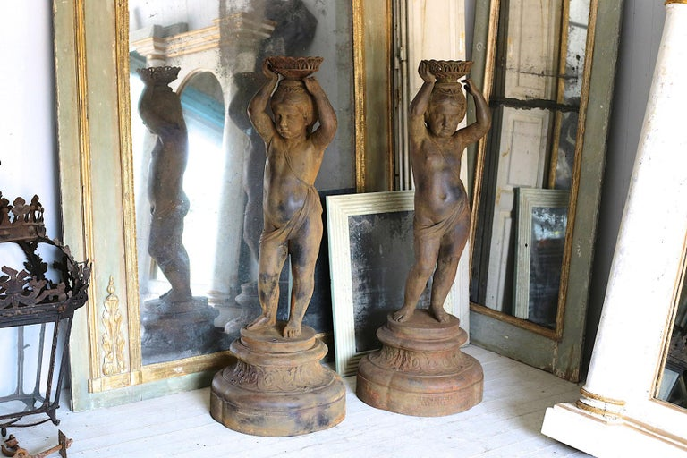 Pair of Cast Iron Girl on Plinths with a Stockholm Foundry Stamp In Good Condition For Sale In Poling, West Sussex