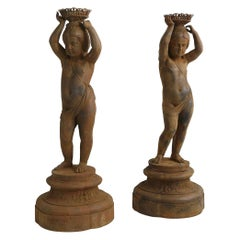Pair of Cast Iron Girl on Plinths with a Stockholm Foundry Stamp