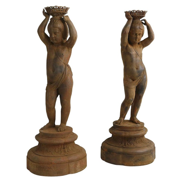Pair of Cast Iron Girl on Plinths with a Stockholm Foundry Stamp For Sale
