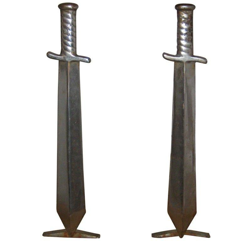 Pair of Cast Iron Sword Andirons, circa 1910 For Sale