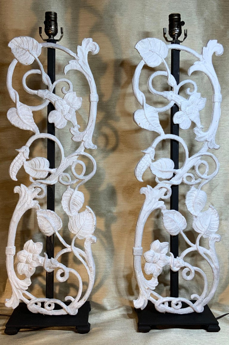Elegant pair of table lamps made of cast iron with flowers and vines motif, hand painted in flat white, professionally mounted on a custom made steel base. Electrified and ready to light. Great decorative pair for any room. Shades are not included.