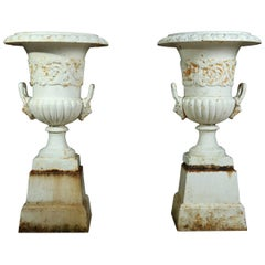 Pair of Cast Iron Urns on Plinth