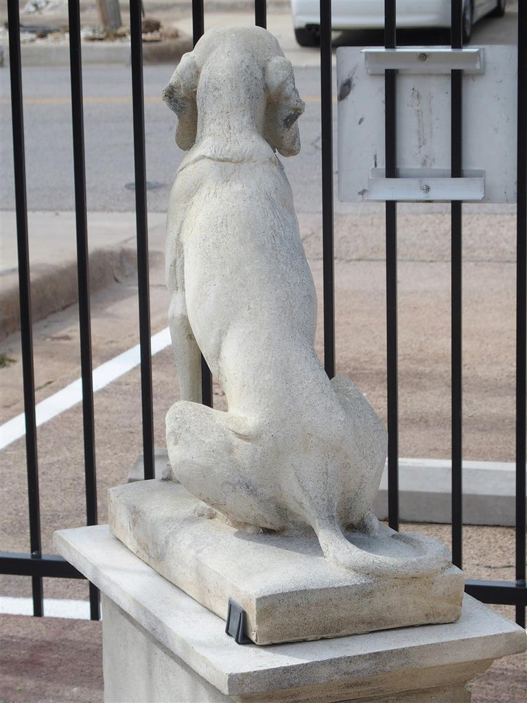 This is a pair of reconstituted cast stone hunting dog statues with matching 3 piece pedestals. Unlike other dog statues on the market, these have incredible lifelike detail due to the fact they are from a mold that is a direct cast from a 140 +