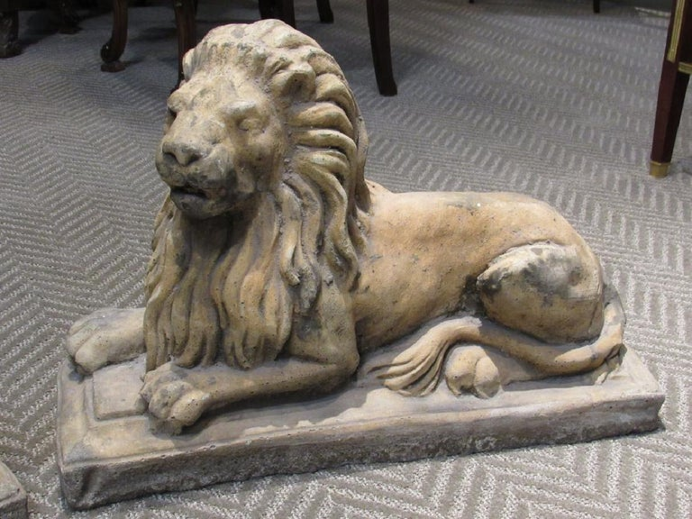 Pair of Cast Stone Garden Lions, Recumbent Lions on Plinth Bases In Good Condition For Sale In Stamford, CT