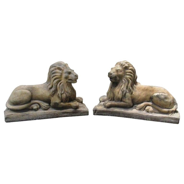 Pair of Cast Stone Garden Lions, Recumbent Lions on Plinth Bases For Sale