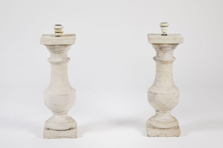 Pair of cast stone lamps.  Measures: 21