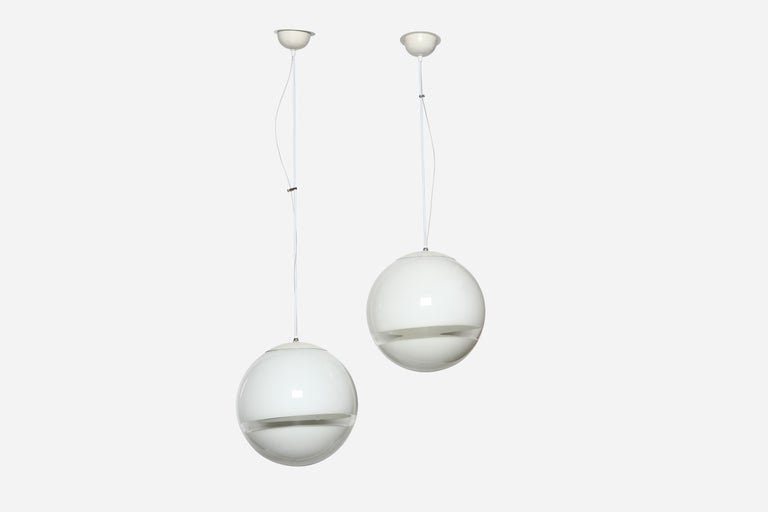 Pair of ceiling pendants by Leucos. Italy 1970s. Rewired from US.  Height adjustable.