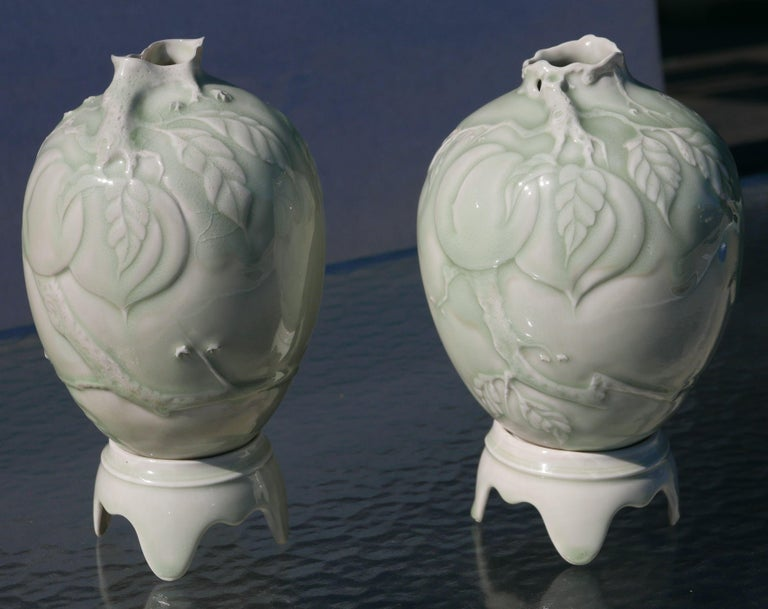 Pair of beautiful vases on pedestals by Master ceramicist Cliff Lee. Cliff Lee is in pretty much every major museum collection you can think of, including the Met, Renwick Gallery at the Smithsonian, the White House Collection of American Crafts,