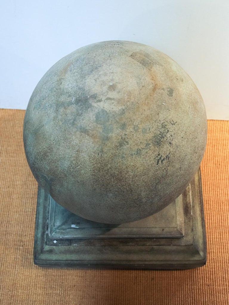 Pair of cast cement globe shaped finials or garden ornaments. Please note of wear consistent with age including minor chips and loss evident on the base.