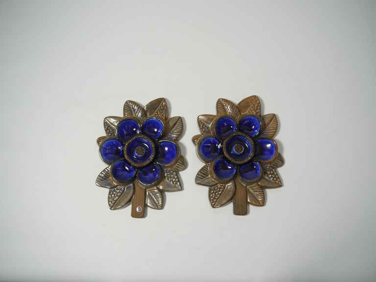 A pair of glazed ceramic flower wall plaques, made by ceramist Irma Yourstone for Upsala Ekeby, Sweden, 1970s.