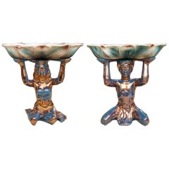 Pair of Ceramic Compotes Depicting Kneeling Figures Holding Shallow Bowls
