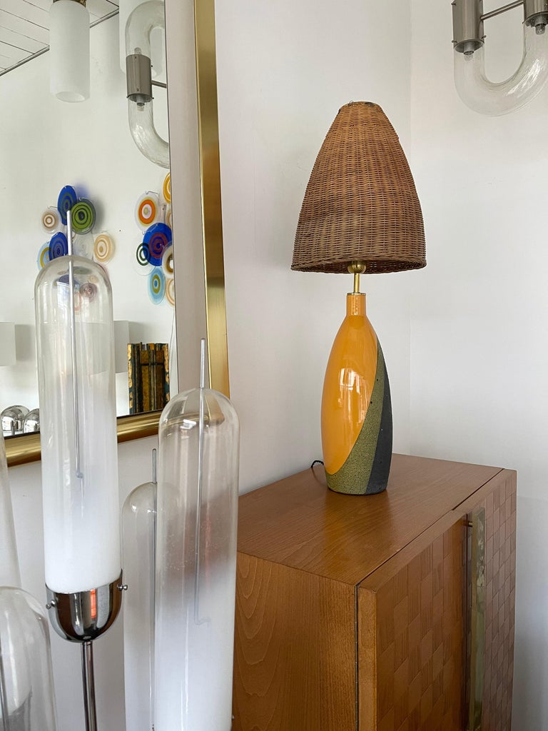 Pair of table or bedside lamps in ceramic terracotta by Ettore Sottsass for the Italian manufacture Bitossi, typical client reference under the lamps from the manufacture. Nice original rattan wicker shades. Famous design like Gambone, Franco Bucci,