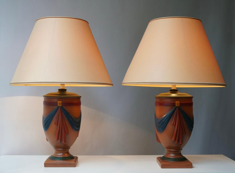 Beautiful set of two Mid-Century Modern ceramic table lamps made in France, circa 1970 by the interior decorator Louis Drimmer, signed at the lamp shades and still retaining the original label.  Measures: Diameter 48 cm. Height 68 cm. Diameter