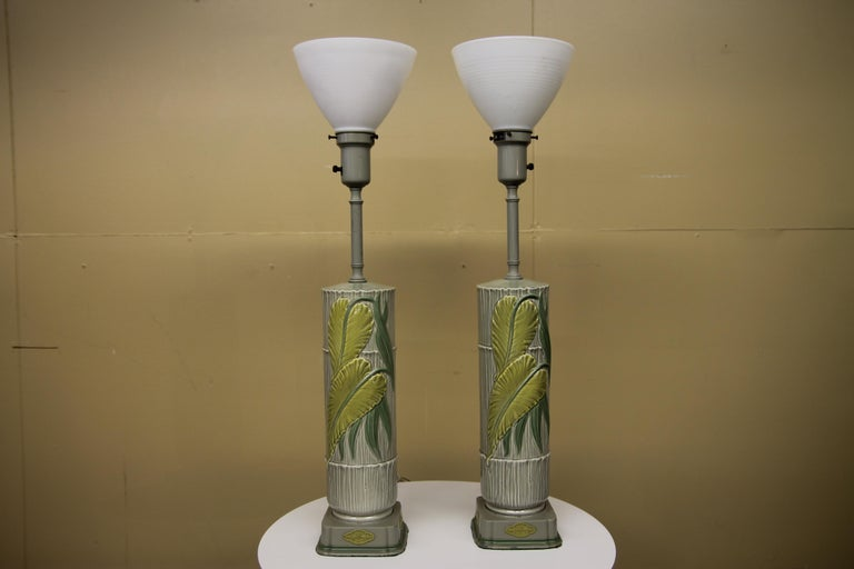 Wonderful pair of Rembrandt table lamps in amazing original condition. These 1950s ceramic lamps have a great tropical feel to them with the look of bamboo and raised leaves. I have not found this example for sale on any sites.