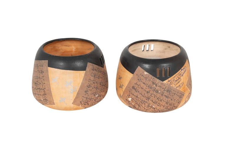 Pair of 19th century ceramic shaped Japanese hibachi's with three vertical incisions either side and paper applique decor.