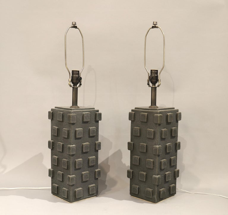 Sculptural ceramic lamps, shaped as columns with square geometric design by studio artist Matthew Ward. Charcoal grey glaze with beautiful tones. Each lamp is signed underneath by the artist.