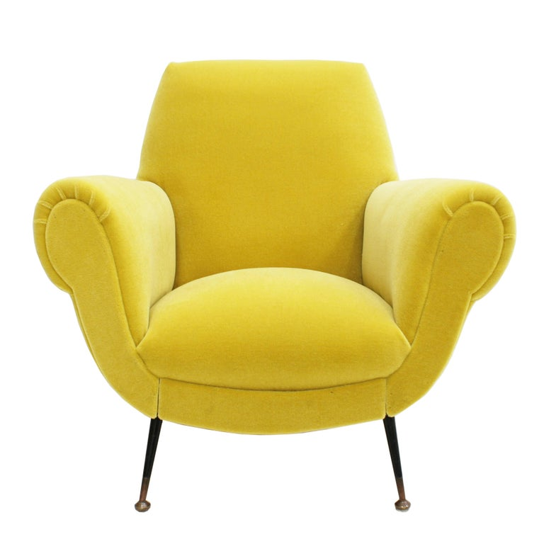 Pair of chairs with solid wood structure with brass legs. Designed by Gigi Radice for Minotti. Upholstered in yellow cotton velvet designed by India Mahdavi for Pierre Frey.