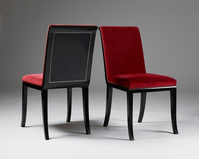 Sweden, 1927-1932. Black lacquered wood, pewter and cotton velvet.  Measures: H: 90 cm/ 35 1/2'' W: 46 cm/ 18'' D: 51 cm/ 20'' Seat height: 45 cm/ 17 3/3''.