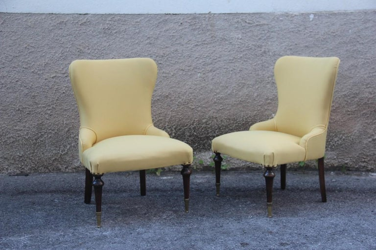 Pair of chairs Mid-Century Modern Italian design Yellow color wood and brass feet.
