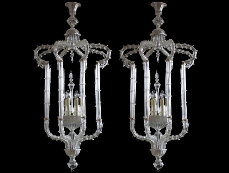 Elegant pair of Chandeliers Cesendello clear color in blown Murano glass, Italy, 1950s. This is a finest pair of chandeliers or considered also as large flush mounts. They are in Ca' Rezzonico style, composed by a series of Murano glass elements