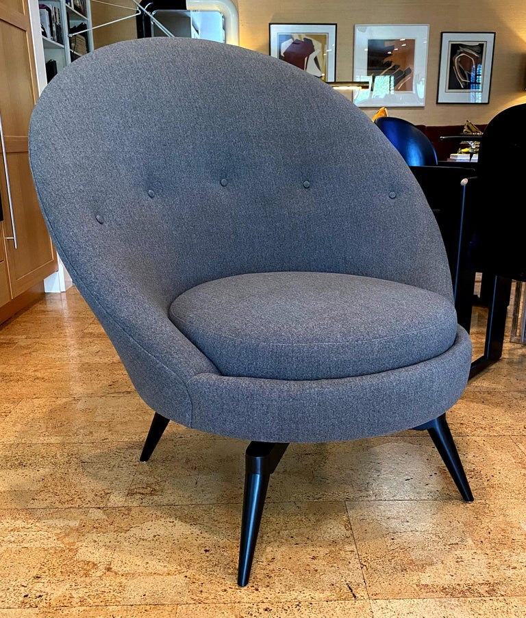 Stunning pair of sculptural swivel chairs in an elegant charcoal gray heavy twill fabric. The bases are finished in an espresso lacquer. The pair swivel 360° on a smooth ball bearing swivel plates.