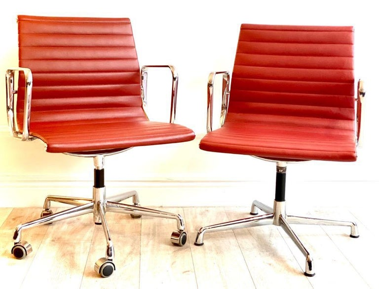 Mid-Century Modern Pair of Charles and Ray Eames Office Chairs in Red Leather