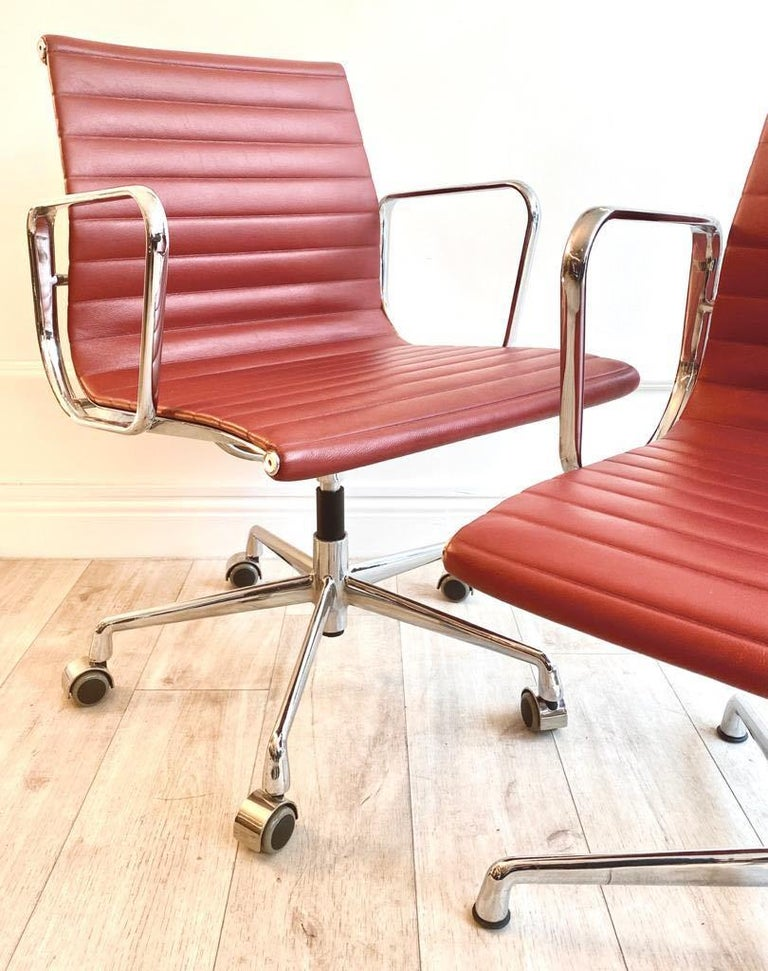 Italian Pair of Charles and Ray Eames Office Chairs in Red Leather
