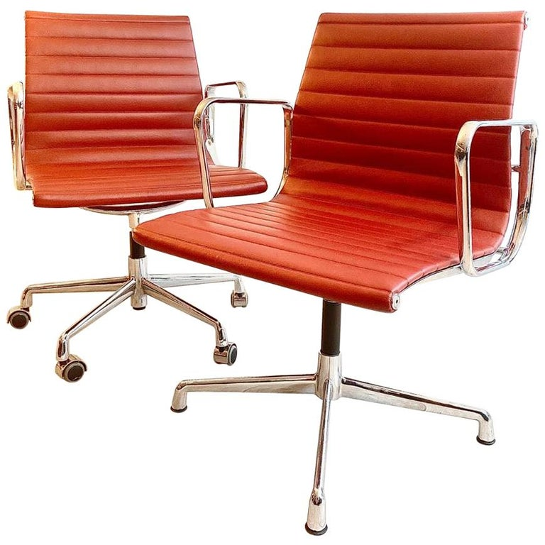 Pair of Charles and Ray Eames Office Chairs in Red Leather