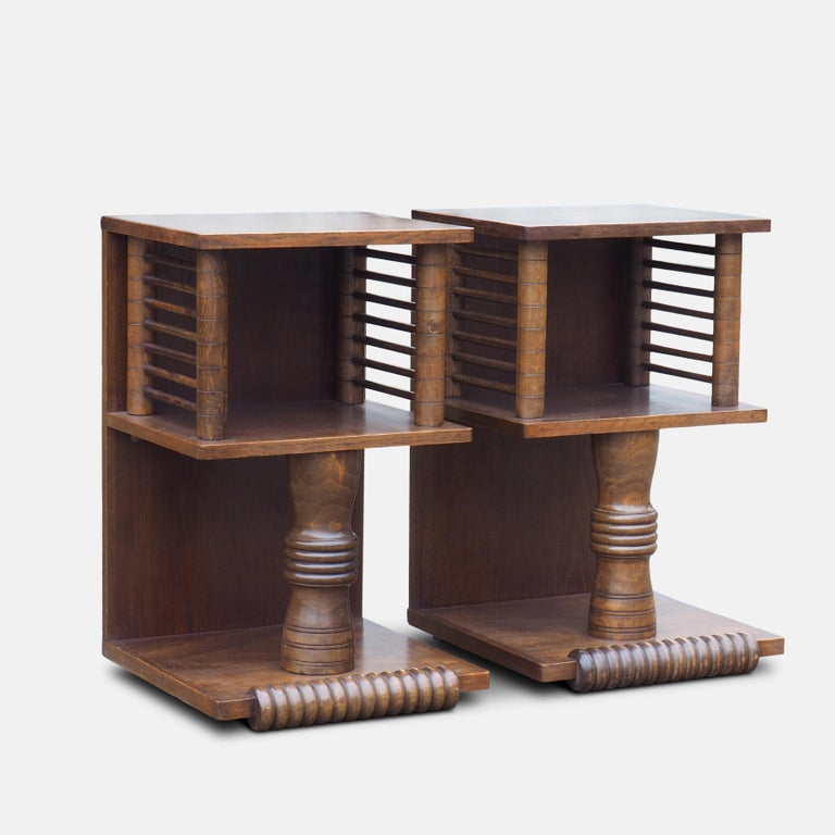 Pair of Charles Dudouyt (1885-1946) French tables, circa 1930. Strongly influenced by African art, these richly carved tables mark a move form Art Deco to the bold abstract forms of Picasso and the modern movement.  An important figure in early