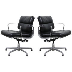 Pair of Charles Eames for Herman Miller Leather Soft Pad Swivel Chairs, Signed