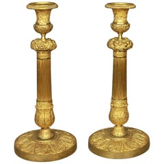 Pair of French Early 19th Century Charles X Gilt-Bronze Candlesticks, circa 1825