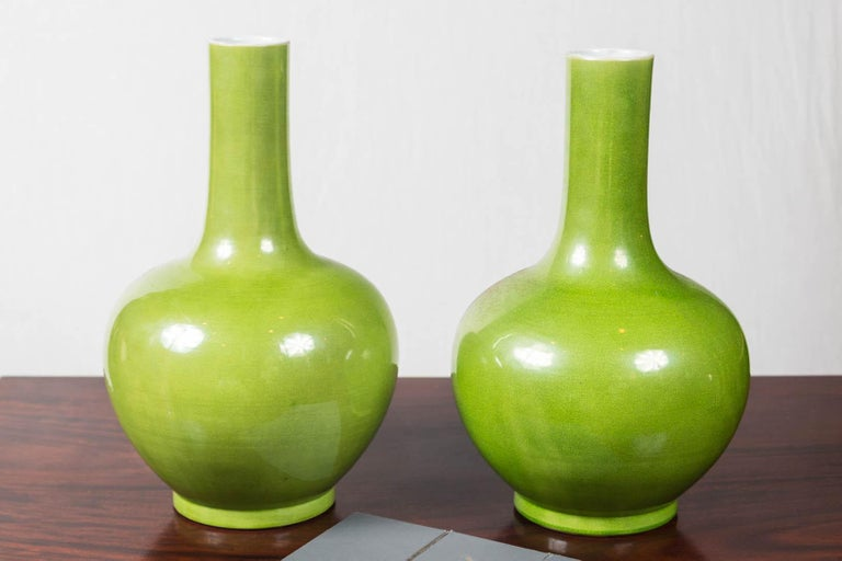 Chinese bottle shape vases in a brilliant yellow/green glaze. unmarked.