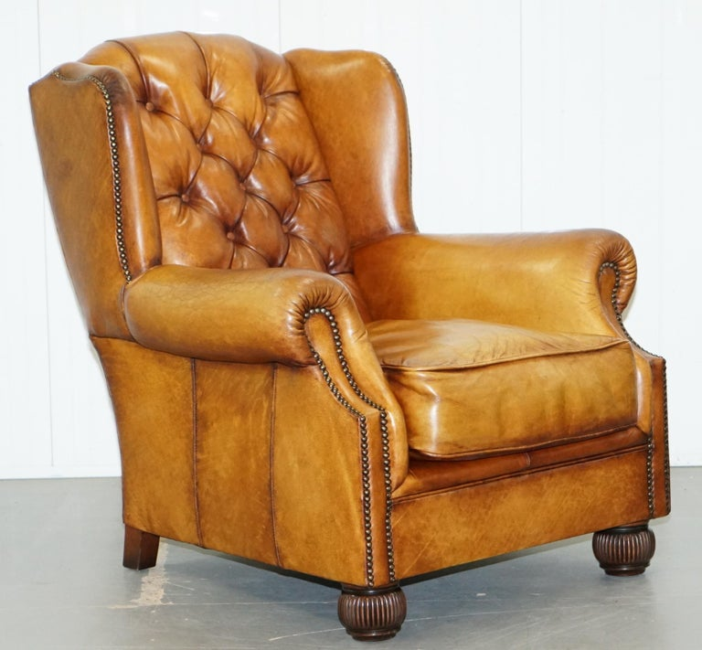 We are delighted to offer for sale this stunning pair of Tetrad Oskar Chesterfield aged brown leather armchairs   One of the most iconic armchairs ever produced by Tetrad, they are exceptionally comfortable, handmade in England, the seat cushions