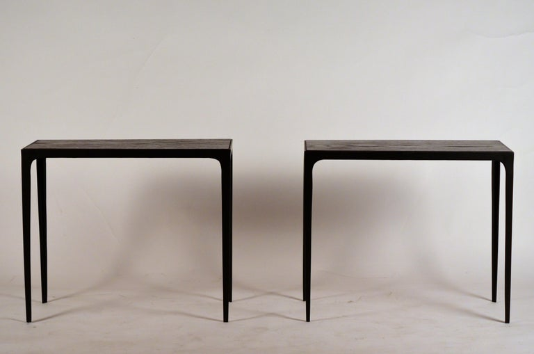 Pair of chic ebonized oak 'Esquisse' side tables by Design Frères. Grooved blackened and sealed oak tops over matte black iron frames.