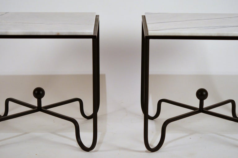 Pair of chic 'Entretoise' veined white quartz side tables by Design Frères.  Rare white quartz with black veining tops.  Also great as a simple night stands or as a 2-part coffee table.