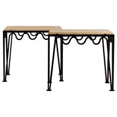 Pair of Chic 'Méandre' Black Iron and Travertine Side Tables by Design Frères