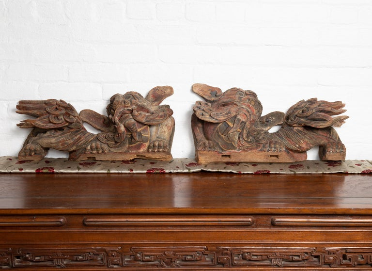 Hand-Carved Pair of Chinese 19th Century Hand Carved and Painted Temple Guardian Lions For Sale