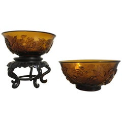 Pair of Chinese Amber Peking Glass Carved Bowls, Qing Dynasty, Late 19th Century