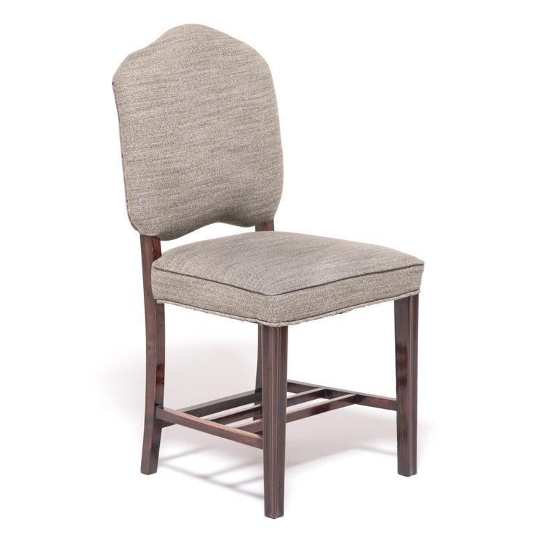 Made in the 1920s to satisfy the worldwide hunger for all things Art Deco, these unique chairs combine the streamlined style of the era with a Classic Chinese aesthetic. The beautiful hardwood frames hint at tradition with bamboo-like modeling and