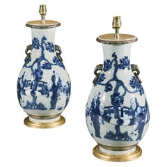 Pair of Chinese Blue and White Decorated Celadon Vases Now Mounted as Lamps