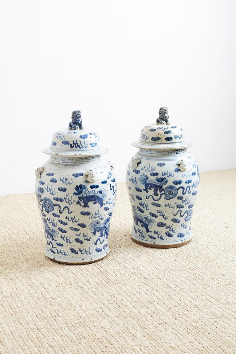 Chinese Export Pair of Chinese Blue and White Ginger Jars with Foo Dogs For Sale