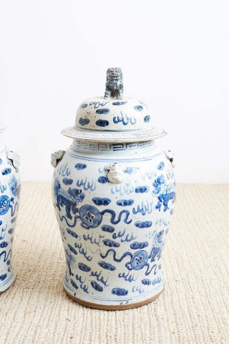 20th Century Pair of Chinese Blue and White Ginger Jars with Foo Dogs For Sale